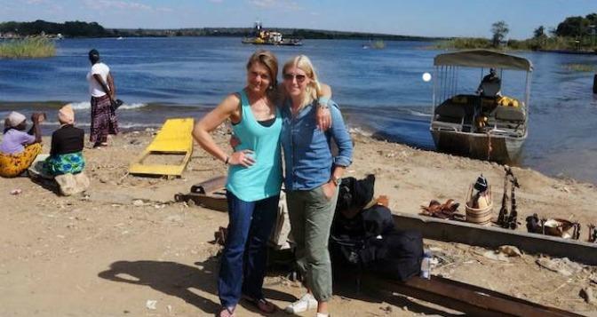 Muriel (left) with Micheala Guzy – Kazangula border crossing – Zambia side